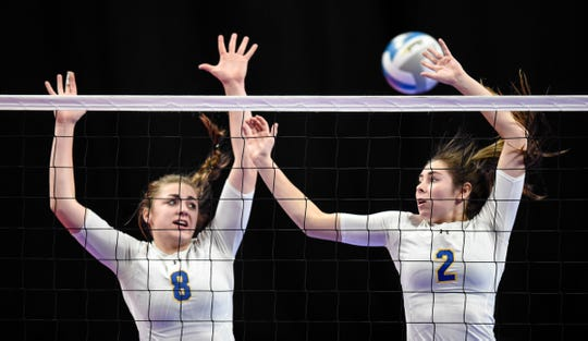 Catehdral's Megan Voit and Lucy Pelzel jump for a block during the state Class 2A quarterfinals Thursday, Nov. 8, at the Xcel Energy Center in St. Paul.