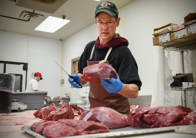 Butcher Pat McAlpine processes roasts, chops and steaks from a customer's deer Friday, Nov. 9, at Von Hanson's Meat Market in Waite Park.