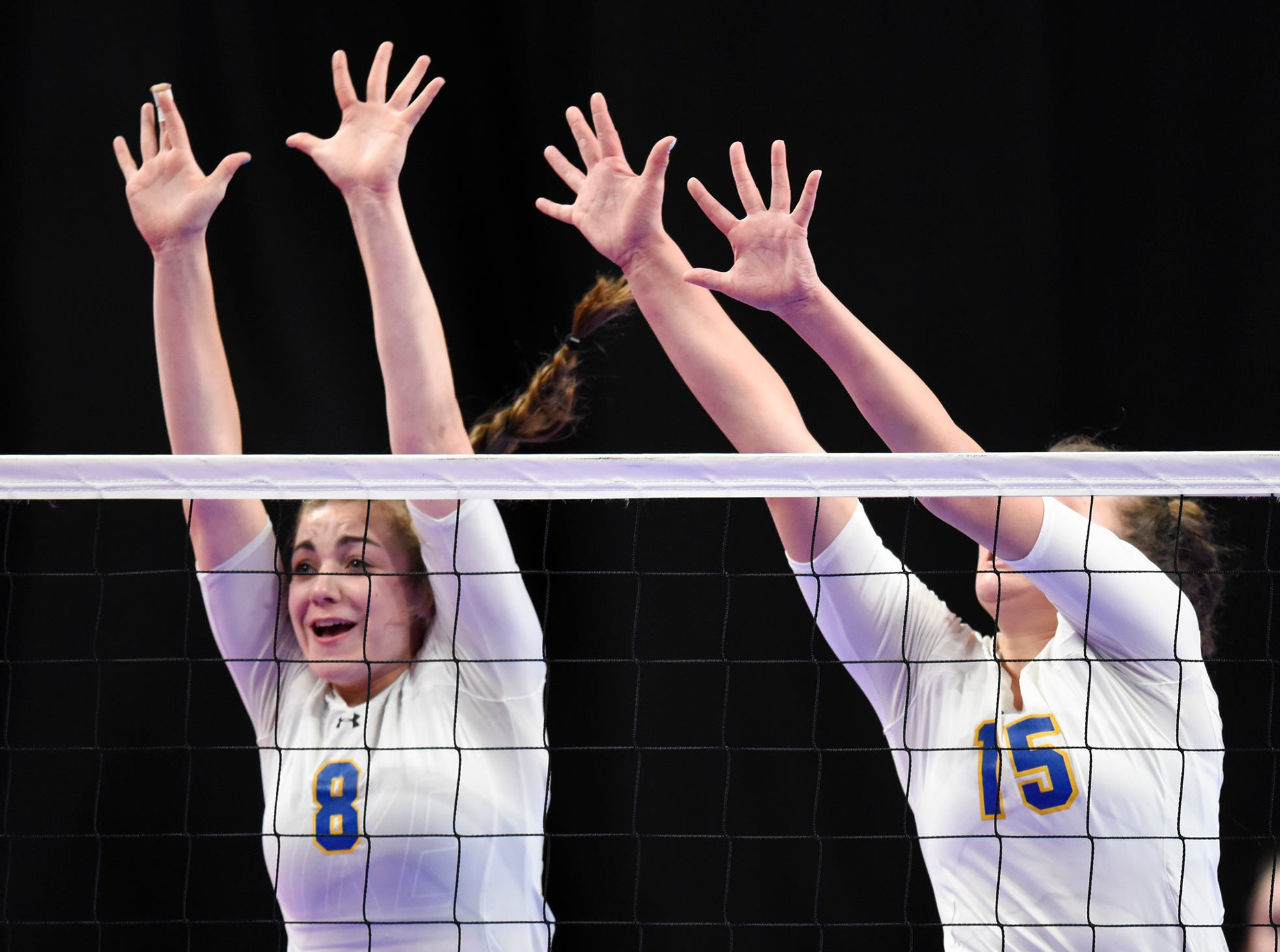 Megan Voit and Gabby Heying attempt a block for Cathedral during the state Class 2A quarterfinals Thursday, Nov. 8, at the Xcel Energy Center in St. Paul.