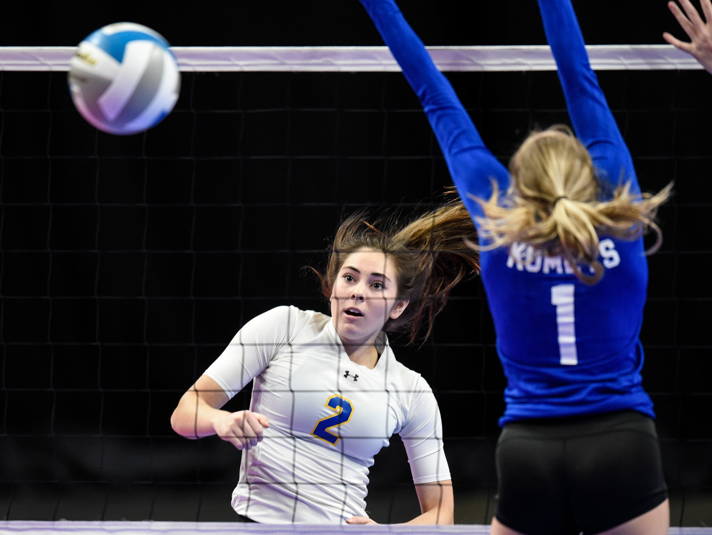 Cathedral's Lucy Pelzel scores a point during the state Class 2A quarterfinals Thursday, Nov. 8, at the Xcel Energy Center in St. Paul.