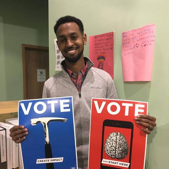 Abdi Daisane helped friends and family vote in the midterm election on Tuesday, Nov. 6, 2018.