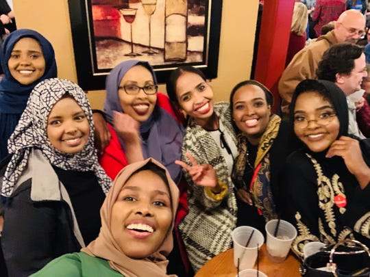 Hudda Ibrahim celebrates election victories at the Red Carpet in St. Cloud with friends on Tuesday, Nov. 6, 2018.
