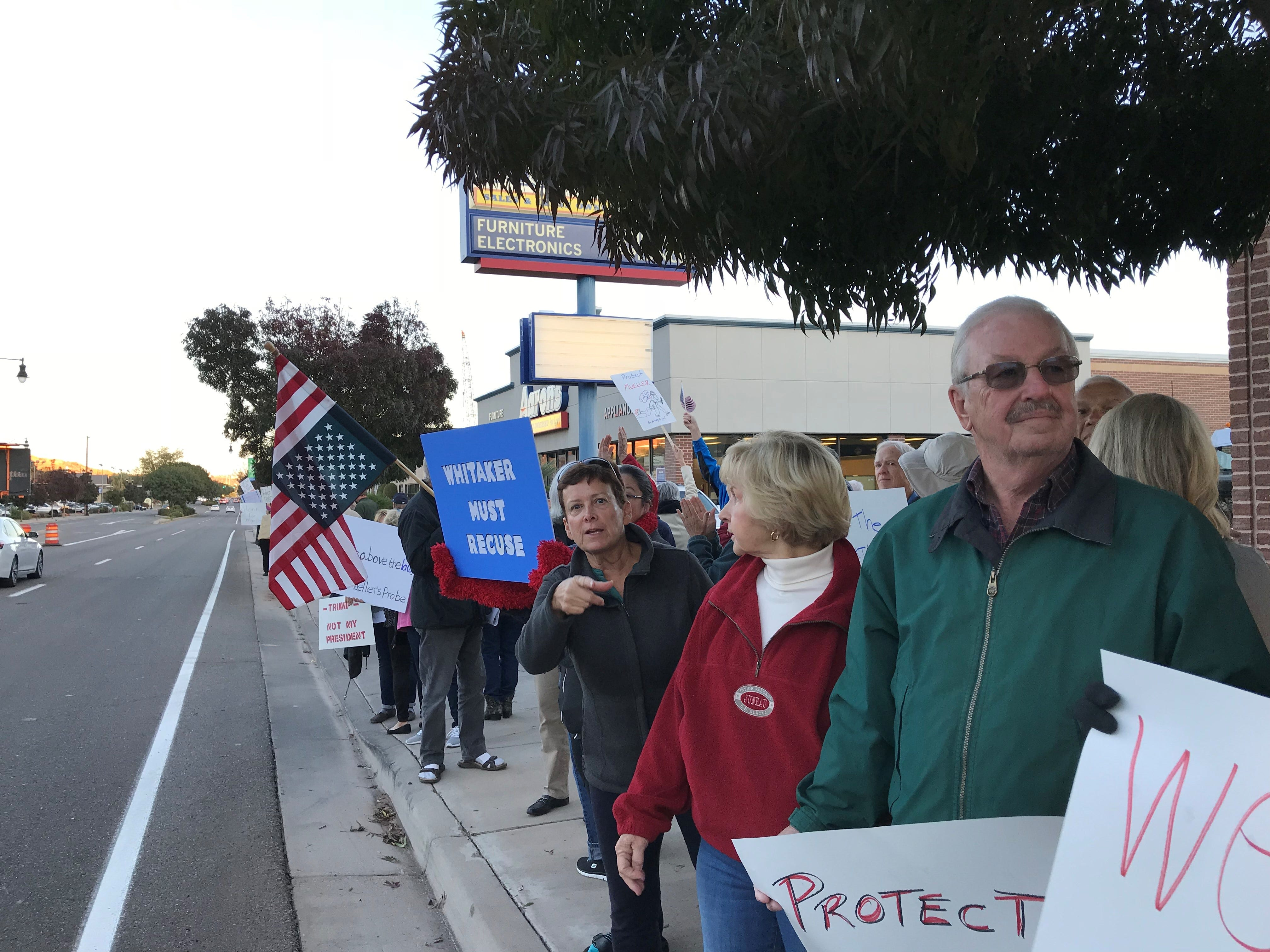Protesters line St. George Blvd. Thursday in response to President Donald Trump's dismissal of Attorney General Jeff Sessions and worries about the future of an ongoing investigation into Russian meddling in the 2016 election. The even was one of hundreds organized across the U.S. November 8, 2018.
