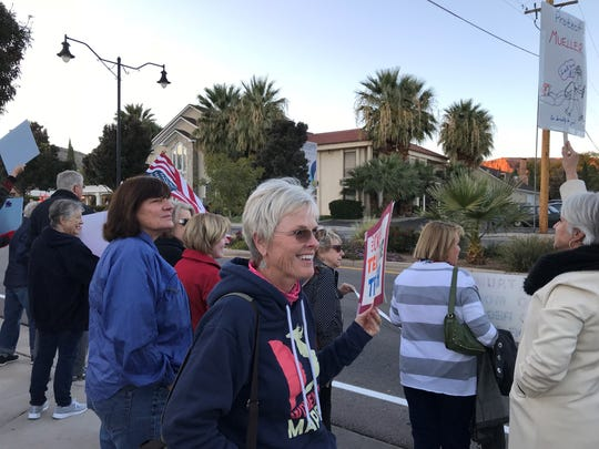 Protesters fill the 200 block of St. George Boulevard holding signs that called for protecting the Russia investigation. Passing cars honked in support. November 8, 2018.