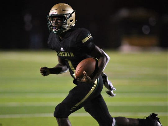 Lincoln quarterback Chris Beard runs for a 10-yard touchdown as Lincoln beat Oakleaf 38-31 in three overtime periods during a Region 1-7A quarterfinal Thursday night at Gene Cox Stadium.