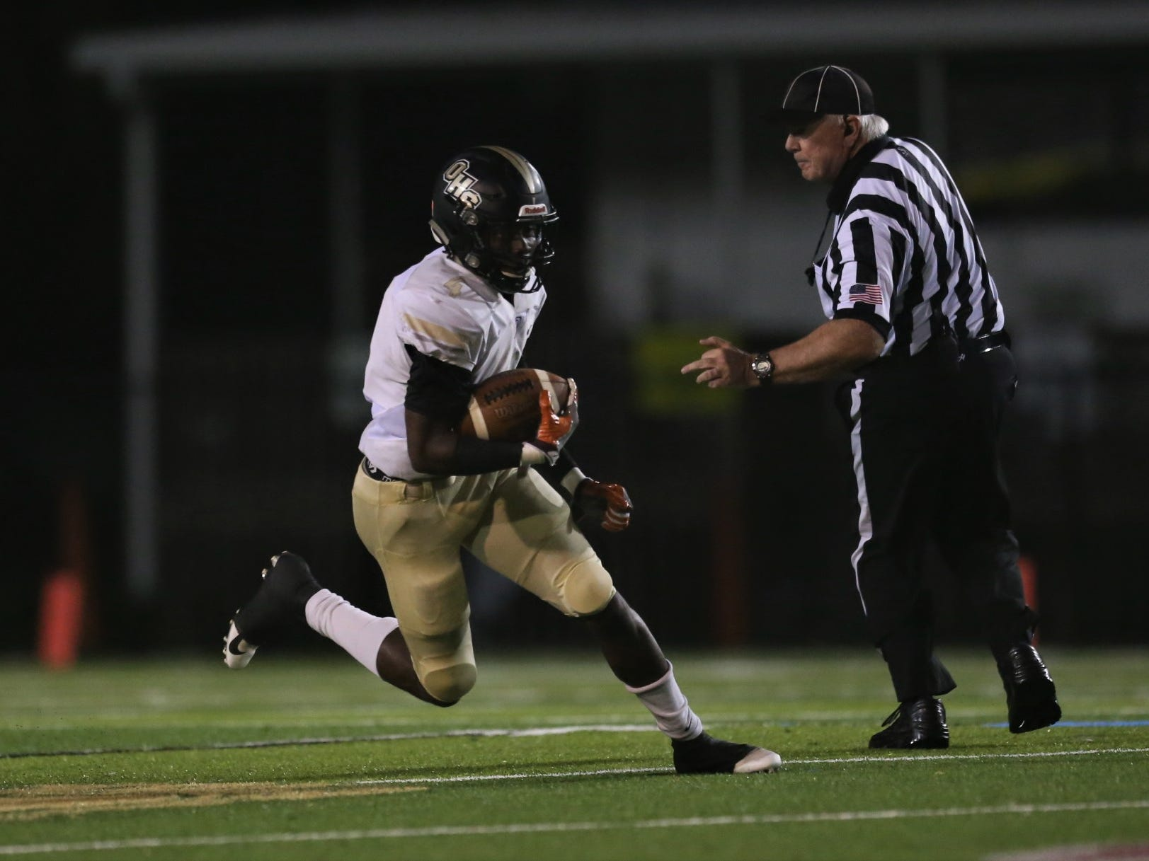 Oakleaf running back Keshawn King finds space to run, but Lincoln beat Oakleaf 38-31 in three overtime periods during a Region 1-7A quarterfinal Thursday night at Gene Cox Stadium.