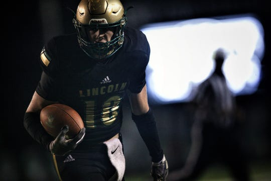 Lincoln receiver Sage Ennis catches a touchdown as Lincoln beat Oakleaf 38-31 in three overtime periods in a  Region 1-7A quarterfinal Thursday night at Gene Cox Stadium.