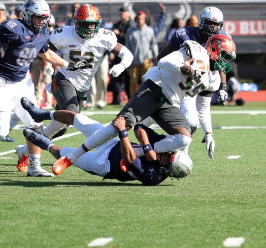 FAMU defensive end Elijah Watkins hauls in an interception off Howard quarterback Caylin Newton.