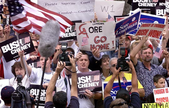 George W. Bush supporters celebrate after the Miami-Dade under vote recount stops outside the Leon County Public Library on Saturday in Tallahassee in 2000.