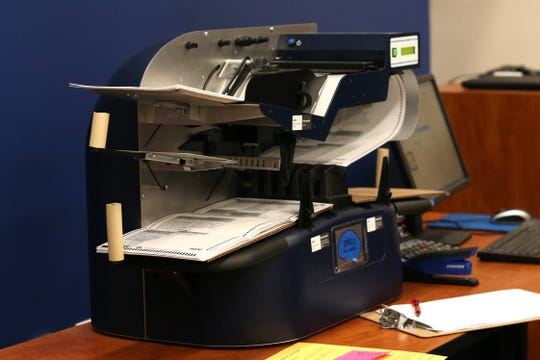 A ballot counting machines tabulates provisional ballots at the Tallahassee Supervisor of Elections Canvassing meeting on Friday, Nov. 9, 2018.