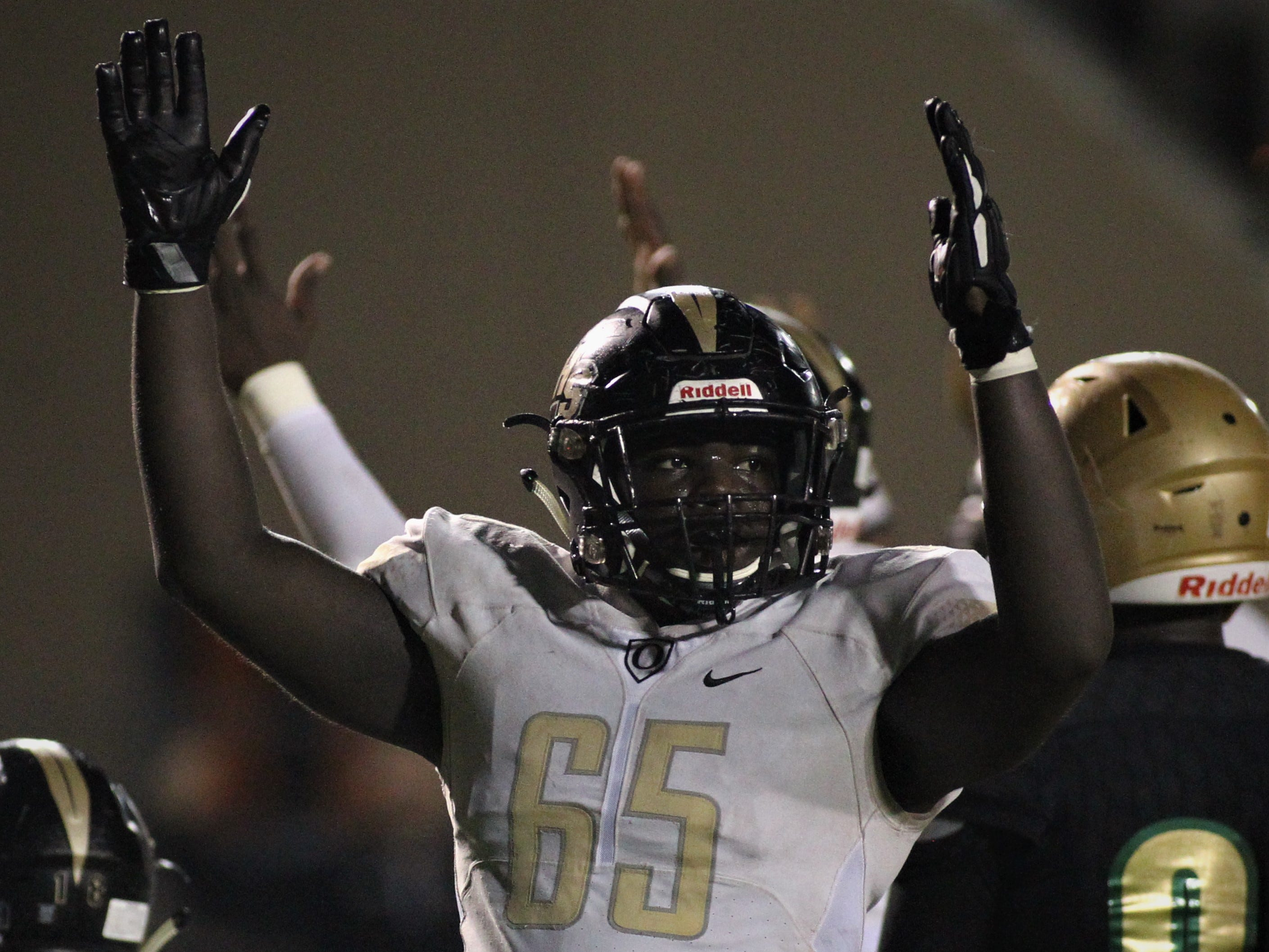 Oakleaf offensive lineman King Solomon celebrates a touchdown, but Lincoln beat Oakleaf 38-31 in three overtime periods during a Region 1-7A quarterfinal Thursday night at Gene Cox Stadium.