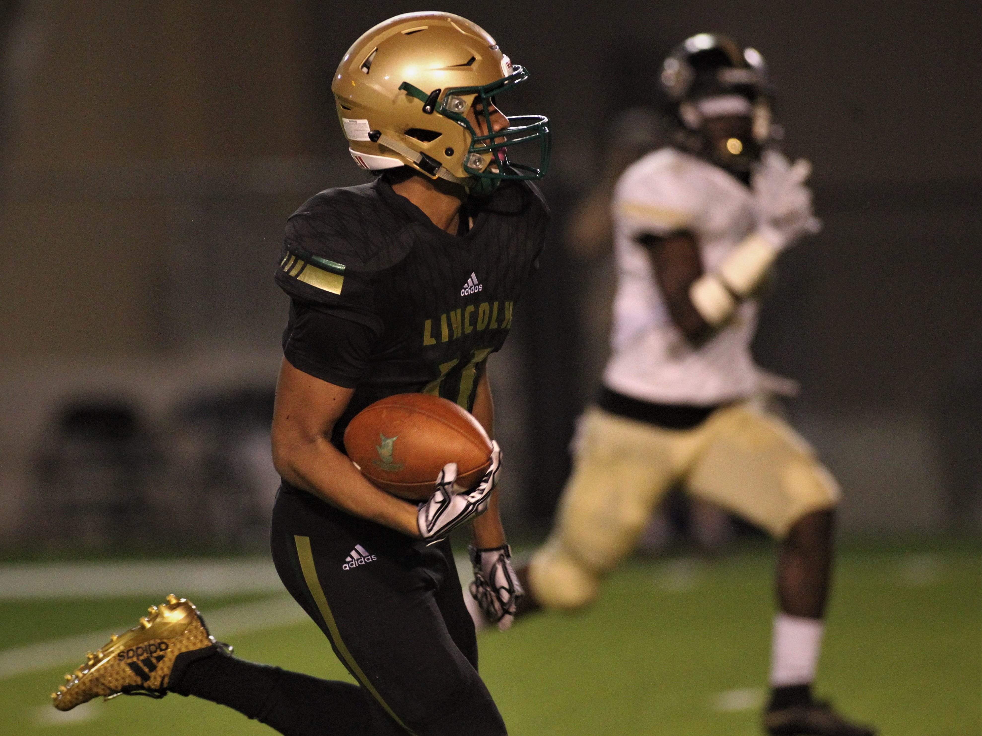 Lincoln receiver Marko Skarica takes off on a long touchdown reception as Lincoln beat Oakleaf 38-31 in three overtime periods during a Region 1-7A quarterfinal Thursday night at Gene Cox Stadium.