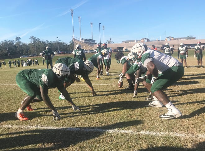 FAMU's offensive linemen call out fronts and pre-snap reads during practice.