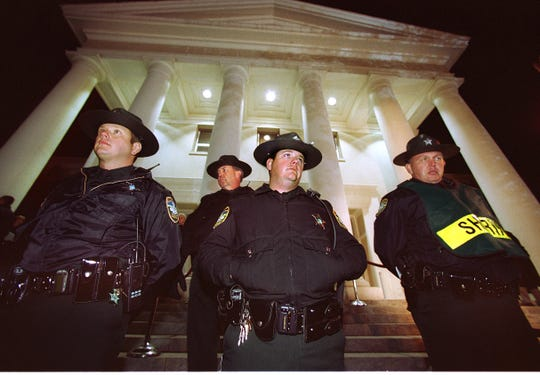 Leon County (FL) Sheriff's Deputies stand guard outside the Florida Supreme Court moments after the recount decision was read Tuesday night, Nov. 21, 2000.