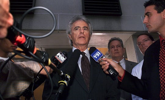 Bush's lead lawyer, Barry Richard, talks to the press on Thursday after the Florida Supreme Court opinion regarding the recount in Palm Beach county.