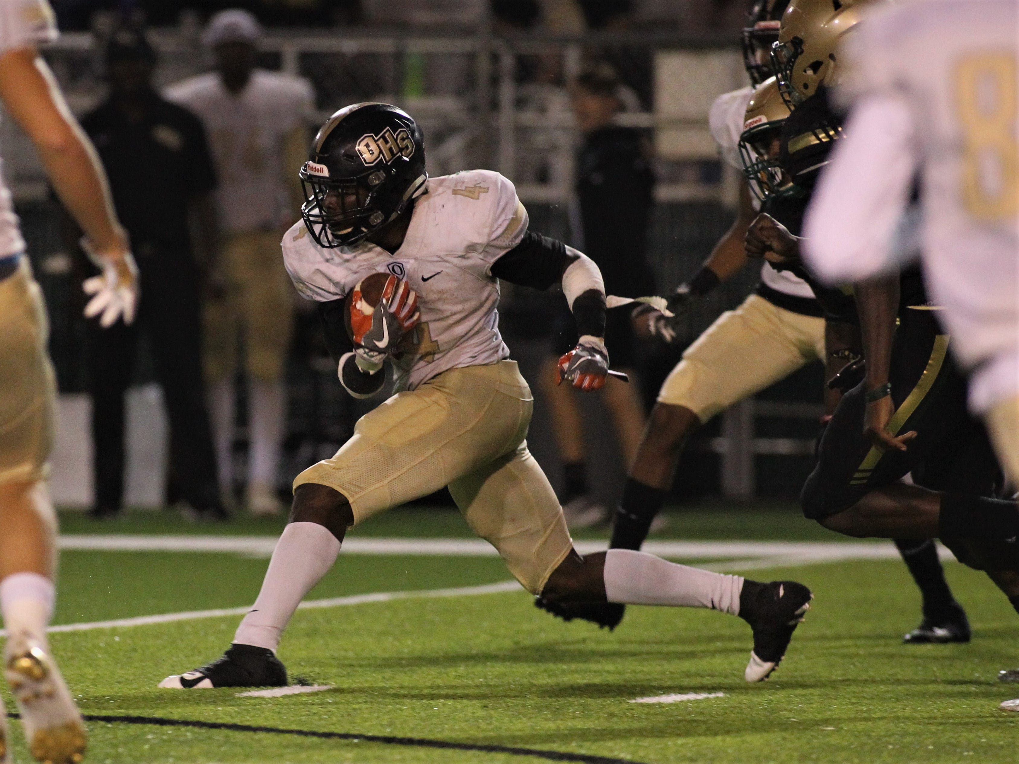 Oakleaf running back Keshawn King runs for yardage as Lincoln beat Oakleaf 38-31 in three overtime periods during a Region 1-7A quarterfinal Thursday night at Gene Cox Stadium.