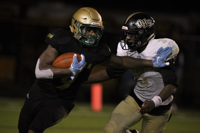 Lincoln tight end Kamari Morales runs for yards after a catch as Lincoln beat Oakleaf 38-31 in three overtime periods during a Region 1-7A quarterfinal Thursday night at Gene Cox Stadium.