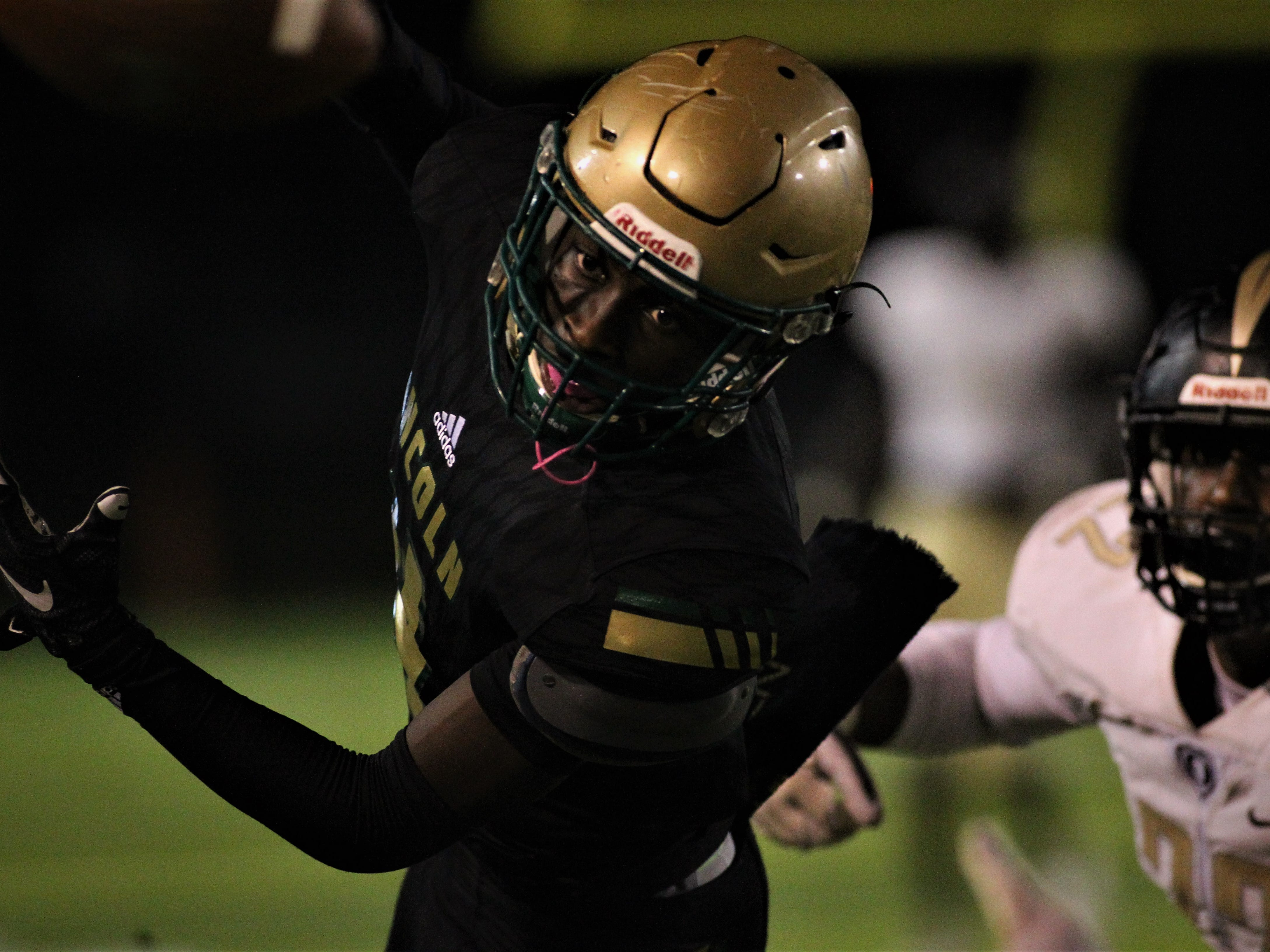 Lincoln quarterback Chris Beard stretches for the goal line as Lincoln beat Oakleaf 38-31 in three overtime periods during a Region 1-7A quarterfinal Thursday night at Gene Cox Stadium.