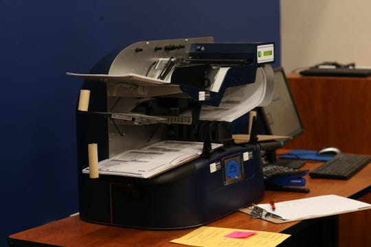 A ballot counting machines tabulates provisional ballots at the Tallahassee Supervisor of Elections Canvassing meeting on Friday, Nov. 9, 2018.