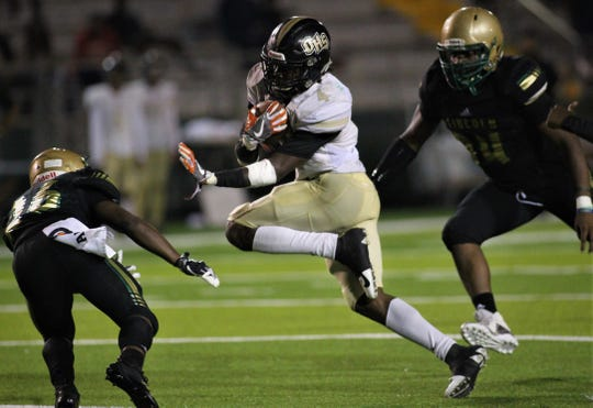 Oakleaf running back Keshawn King runs for yards as Lincoln beat Oakleaf 38-31 in three overtime periods during a Region 1-7A quarterfinal Thursday night at Gene Cox Stadium.