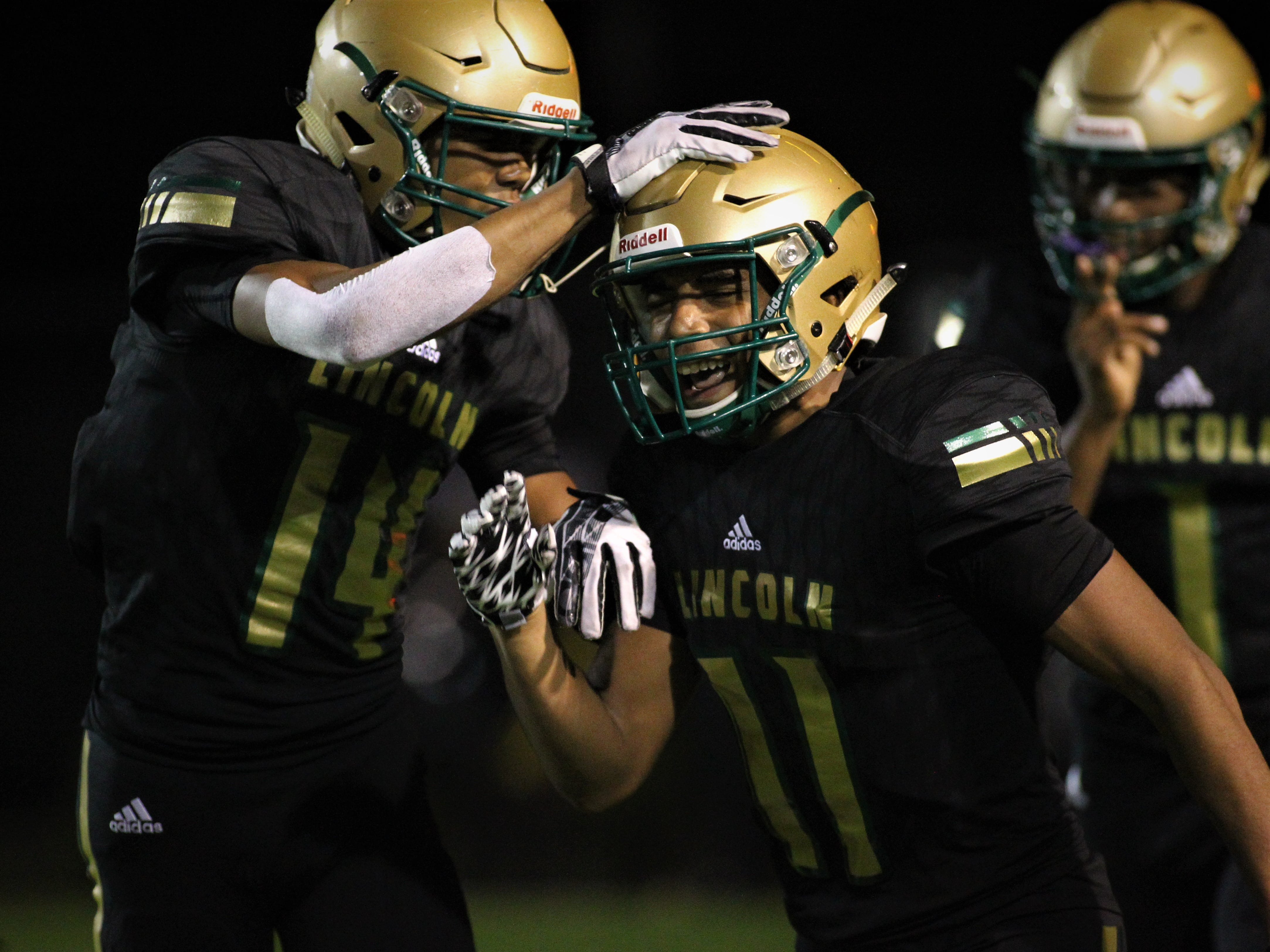Lincoln receiver Marko Skarica is congratulated on a touchdown catch by Kamron Lawrence as Lincoln beat Oakleaf 38-31 in three overtime periods during a Region 1-7A quarterfinal Thursday night at Gene Cox Stadium.