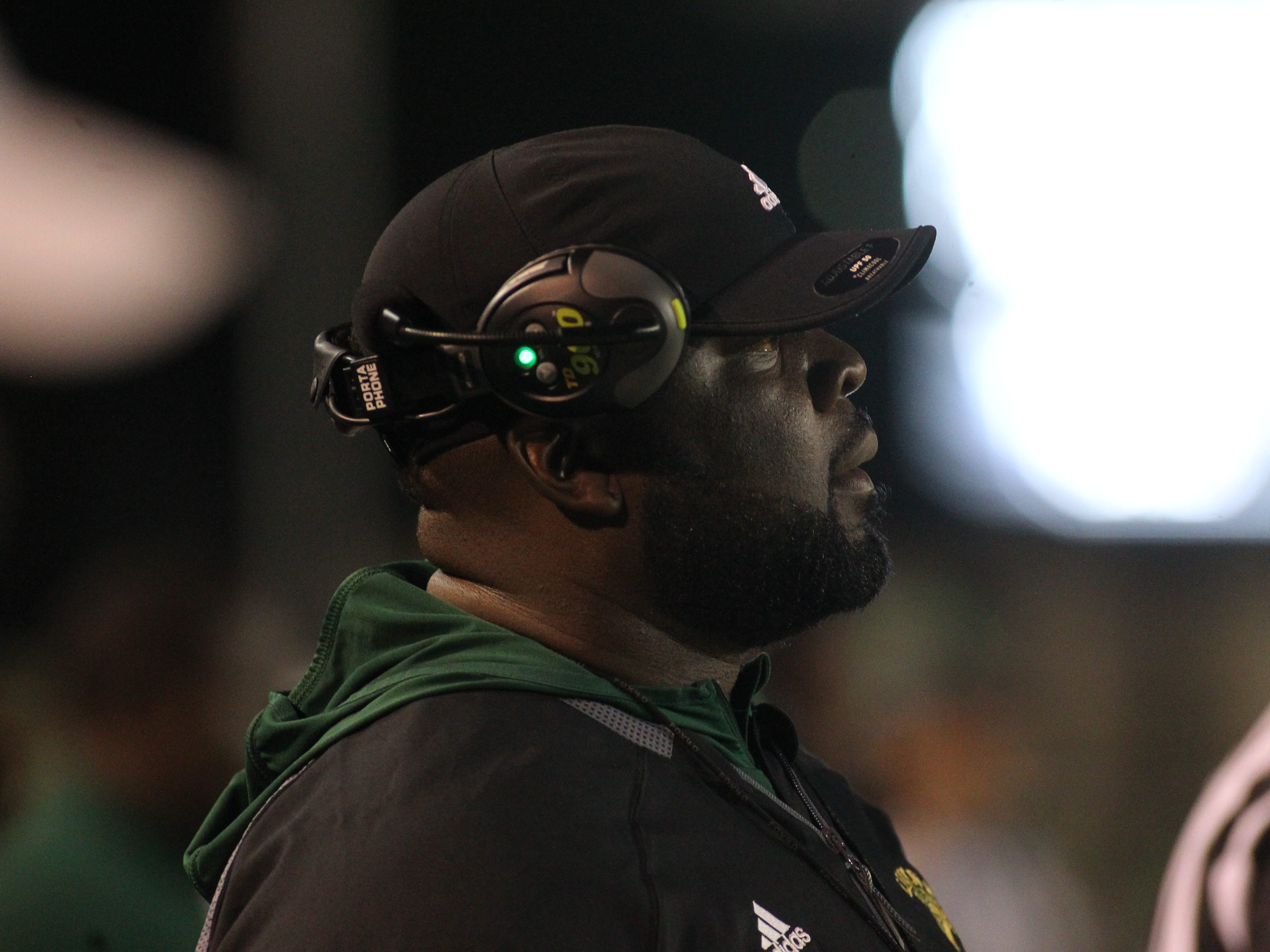 Lincoln head coach Quinn Gray watches as Lincoln beat Oakleaf 38-31 in three overtime periods during a Region 1-7A quarterfinal Thursday night at Gene Cox Stadium.