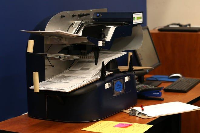 A ballot counting machines tabulates provisional ballots at the Tallahassee Supervisor of Elections Canvassing meeting.
