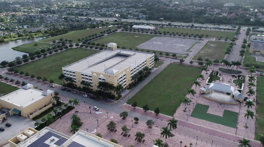 The sale of the 21-acre City Center at the corner of U.S. 1 and Walton Road in Port St. Lucie hinges on negotiations between city officials and a prospective buyer regarding the city assessments associated with the property.