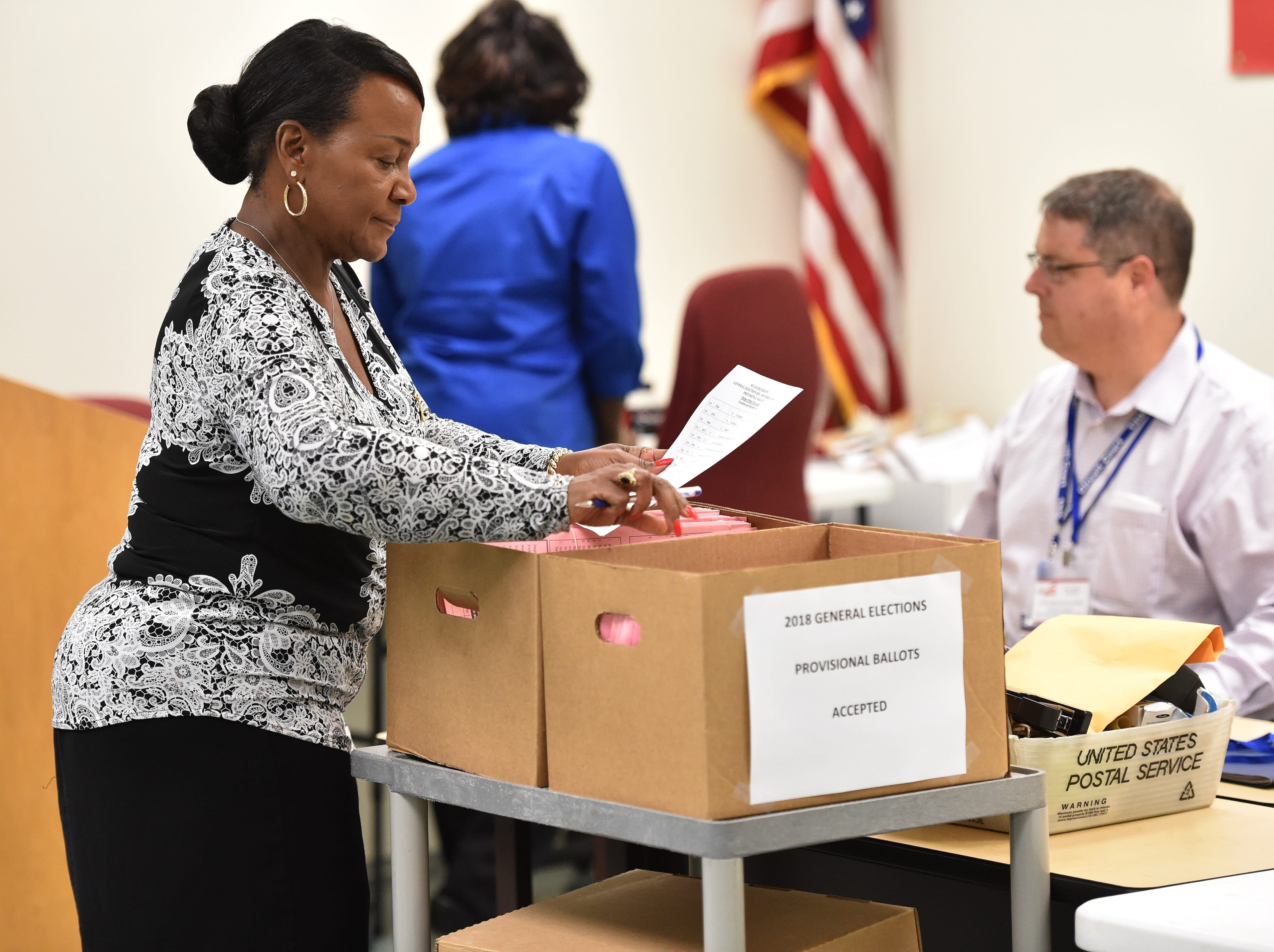 Members of the St. Lucie County Supervisor of Elections canvassing board review provisional ballots to be verified or rejected on Thursday, Nov. 8, 2018, at their office in Fort Pierce. A provisional ballot is a ballot that is counted only when the Supervisor of Elections office can verify the person who cast it is eligible to vote.