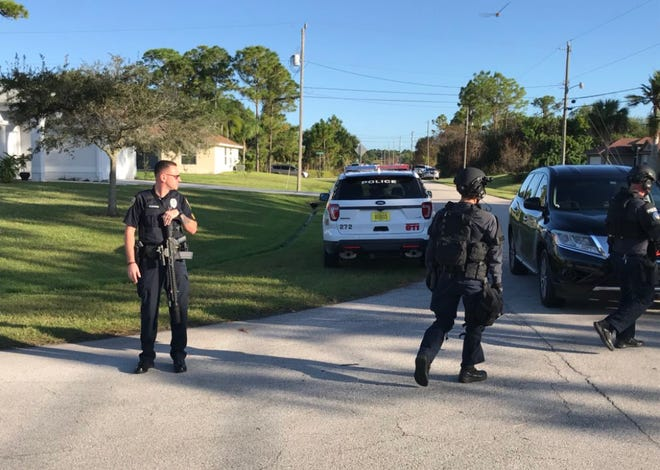 A SWAT team was at the scene where an armed man was inside a home in the 1700 block of Southwest Cammargo Street in Port St. Lucie on Friday, Nov. 9, 2018.