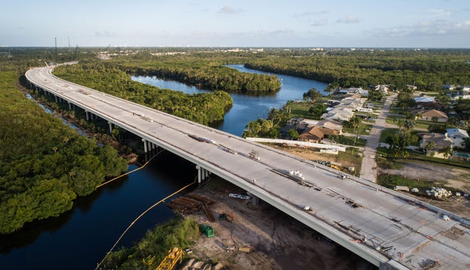 The Crosstown Parkway bridge is seen while still under construction looking east over the St. Lucie River on Thursday, Nov. 8, 2018, in Port St. Lucie. When completed, the bridge will be 4,100 feet long; have 284 beams and 366 piles, each of which must support 400 tons. A total of 14,600 cubic yards of concrete will be used.