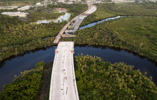 The under-construction Crosstown Parkway bridge is seen looking east over the St. Lucie River on Thursday, Nov. 8, 2018, in Port St. Lucie.