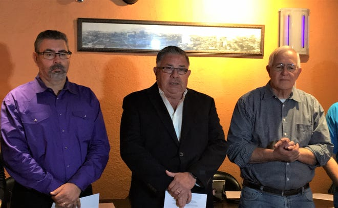 L&J Cafe owner Leo A. Duran Sr., center, at a Friday news conference in his restaurant asks that more El Paso restaurants join in helping immigrant shelters. Martin Rios, owner of The Lunch Box restaurant, is on the left and Ruben Garcia, executive director of Annunciation House, is on the right.