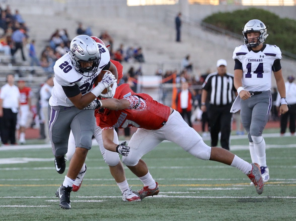 Lineman Tony Cerros nearly breaks a blocked extra point for a touchdown.