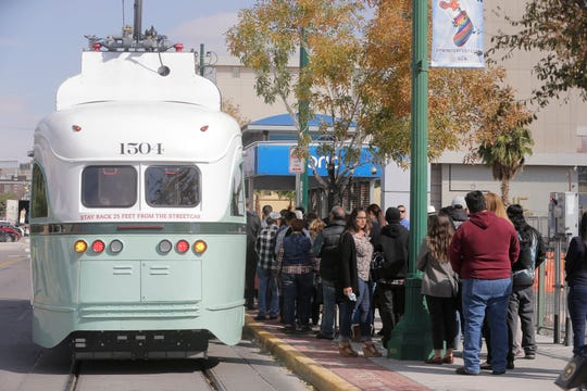 Friday afternoon the City of El Paso launched its much-awaited El Paso Streetcar service. The launching ceremony featured all three different color schemes of the newly restored Presidents Conference Committee (PCC) Streetcars and its first streetcars filled with passengers. Here El Pasoans stand in line to some of the first to take a ride on the streetcars through downtown El Paso.