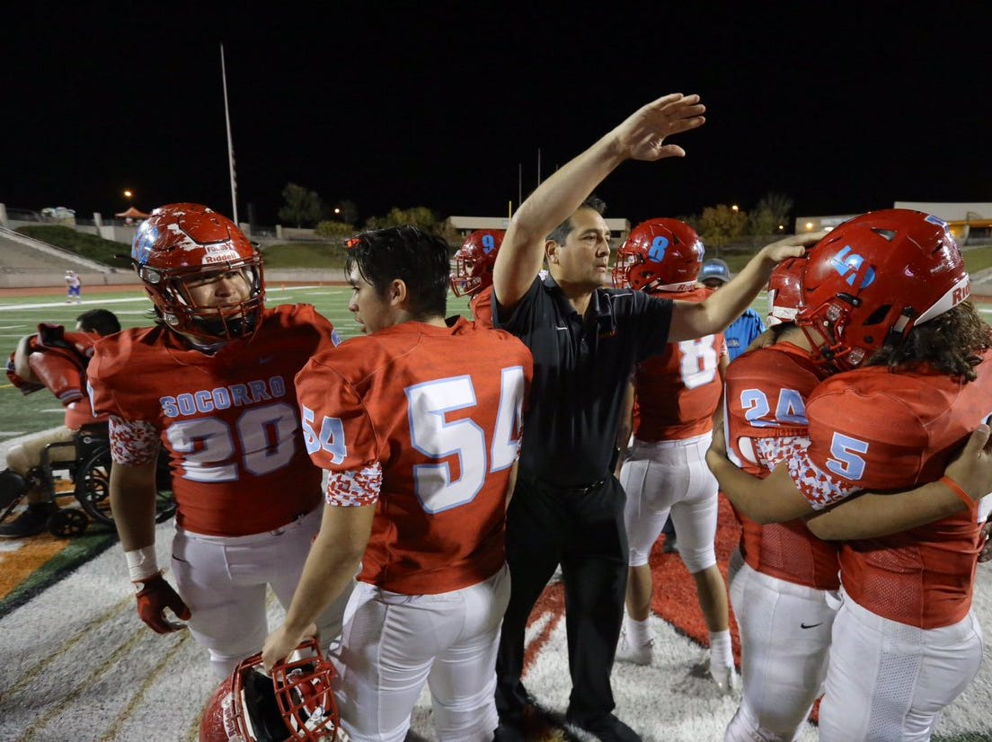 The Socorro High School football team leaves the field after their loss to the Franklin High Cougars at the SAC.