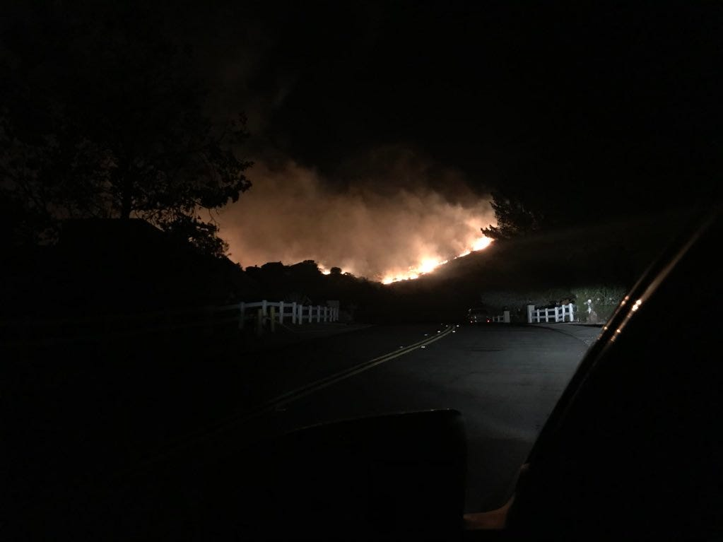 This is a view of the Woolsey Fire's flames from Hackamore Lane in Bell Canyon on Friday.