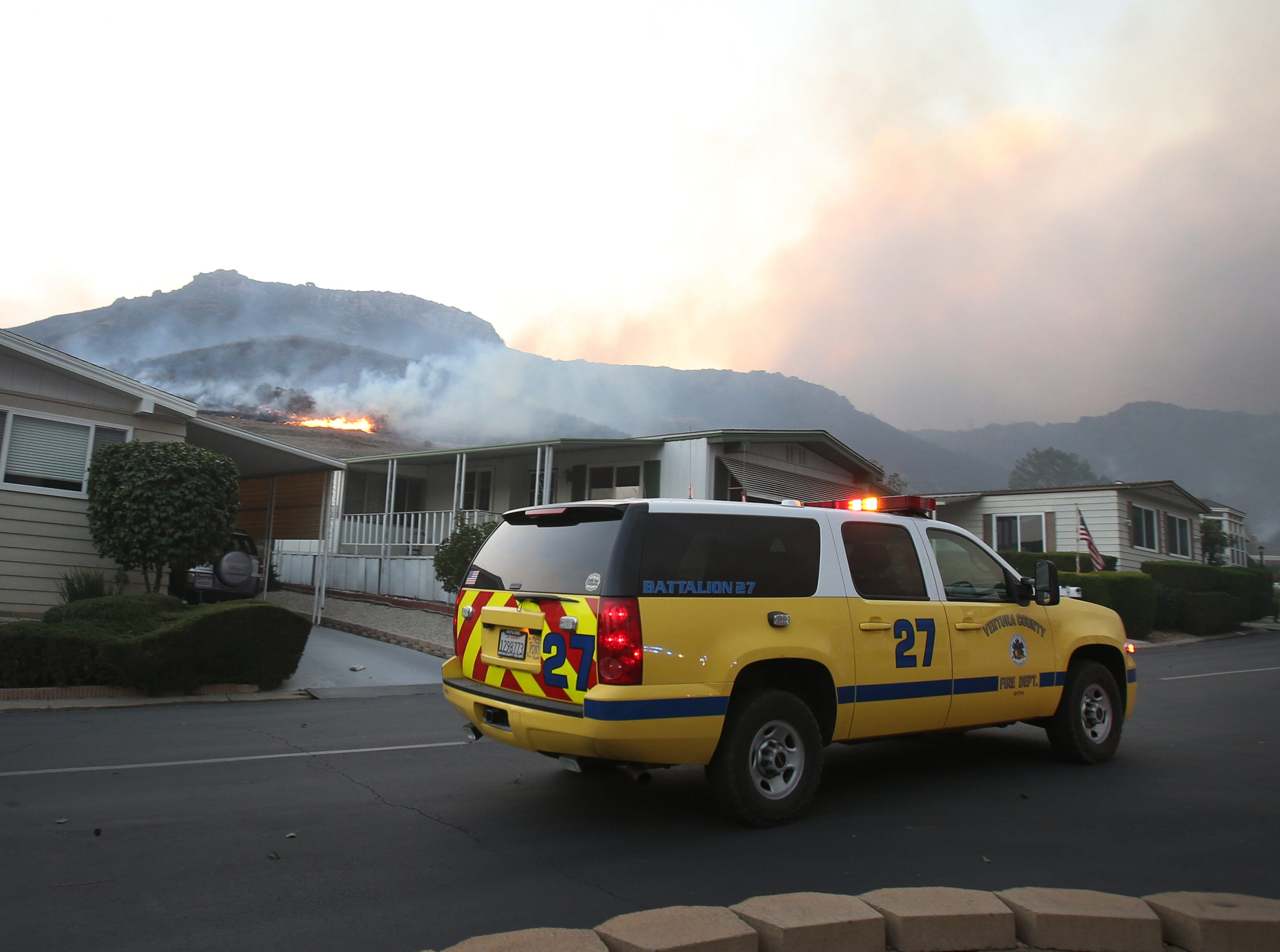 The Ventura County Fire Department patrols the mobile park off Old Conejo  Road in Newbury Park as flames from the Hill Fire come close to structures.