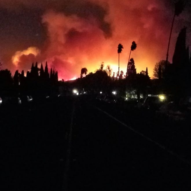 The Woolsey Fire burns in the Conejo Valley early Friday after moving in from the north. It started in the area of the old Rocketdyne facility near Simi Valley.