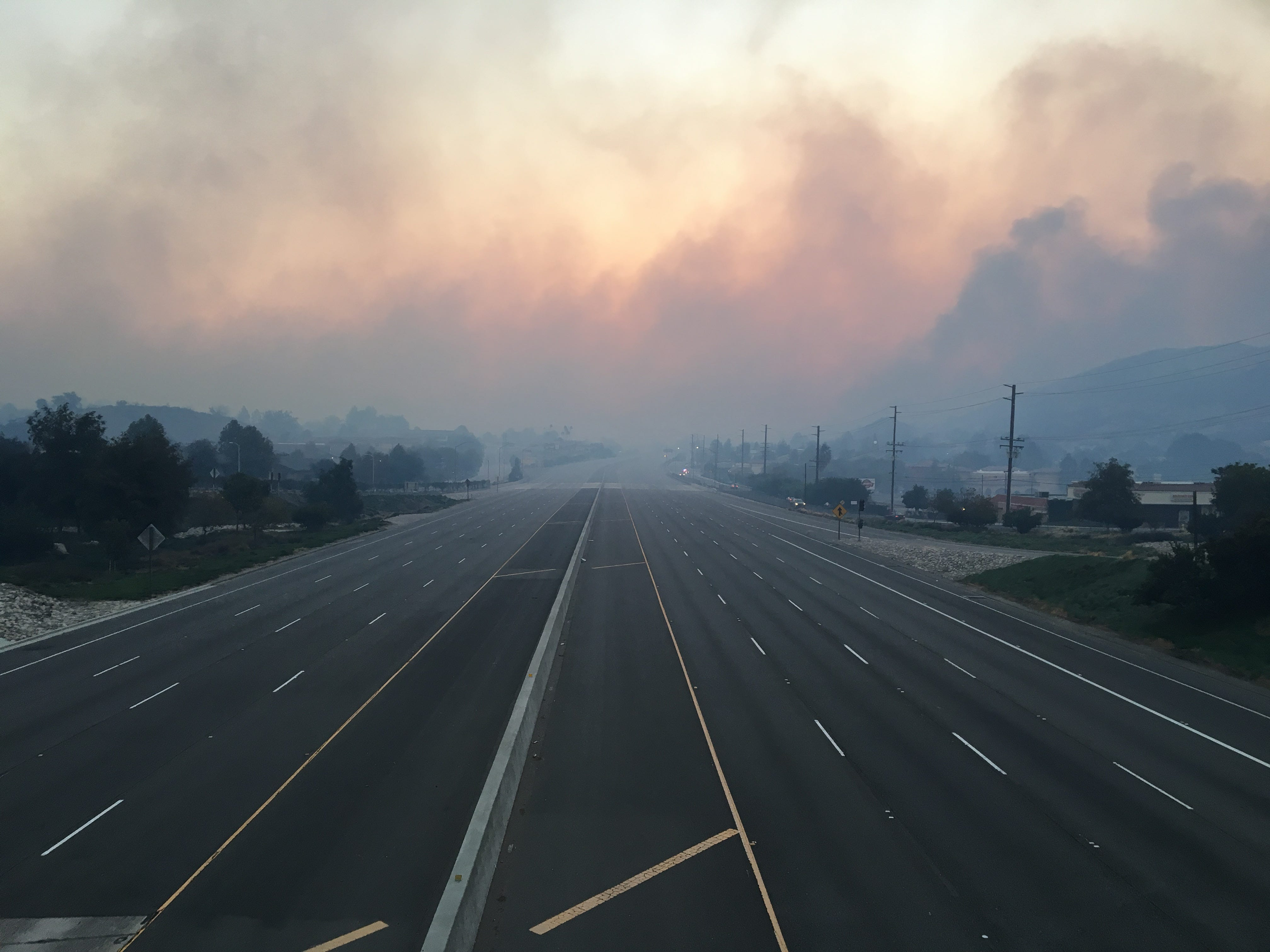 Highway 101 was mostly empty after flames from the Woolsey Fire jumped Highway 101 near Palo Comado Canyon Road on Friday morning.