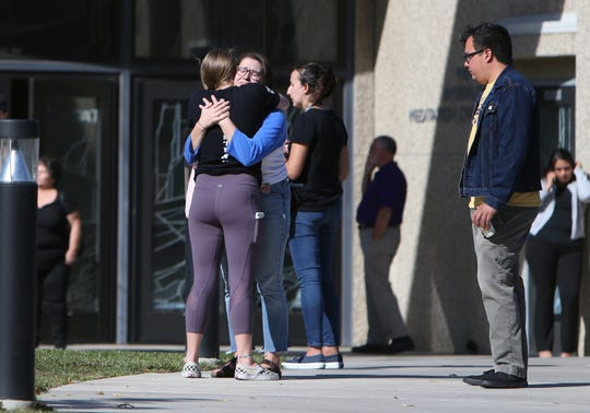 Cal Lutheran students console each other before a service Thursday held at the university's chapel for the victims of the Borderline Bar Borderline Bar & Grill shooting.