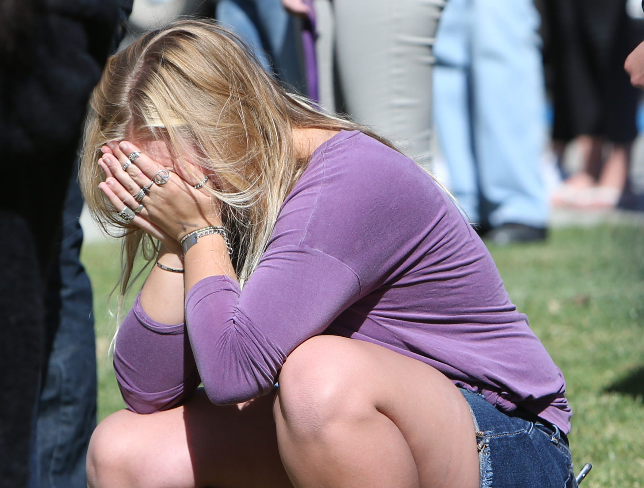 A Cal Lutheran student is overcome with grief during a service held at the university's chapel Thursday for the victims of the Borderline Bar Borderline Bar & Grill shooting.