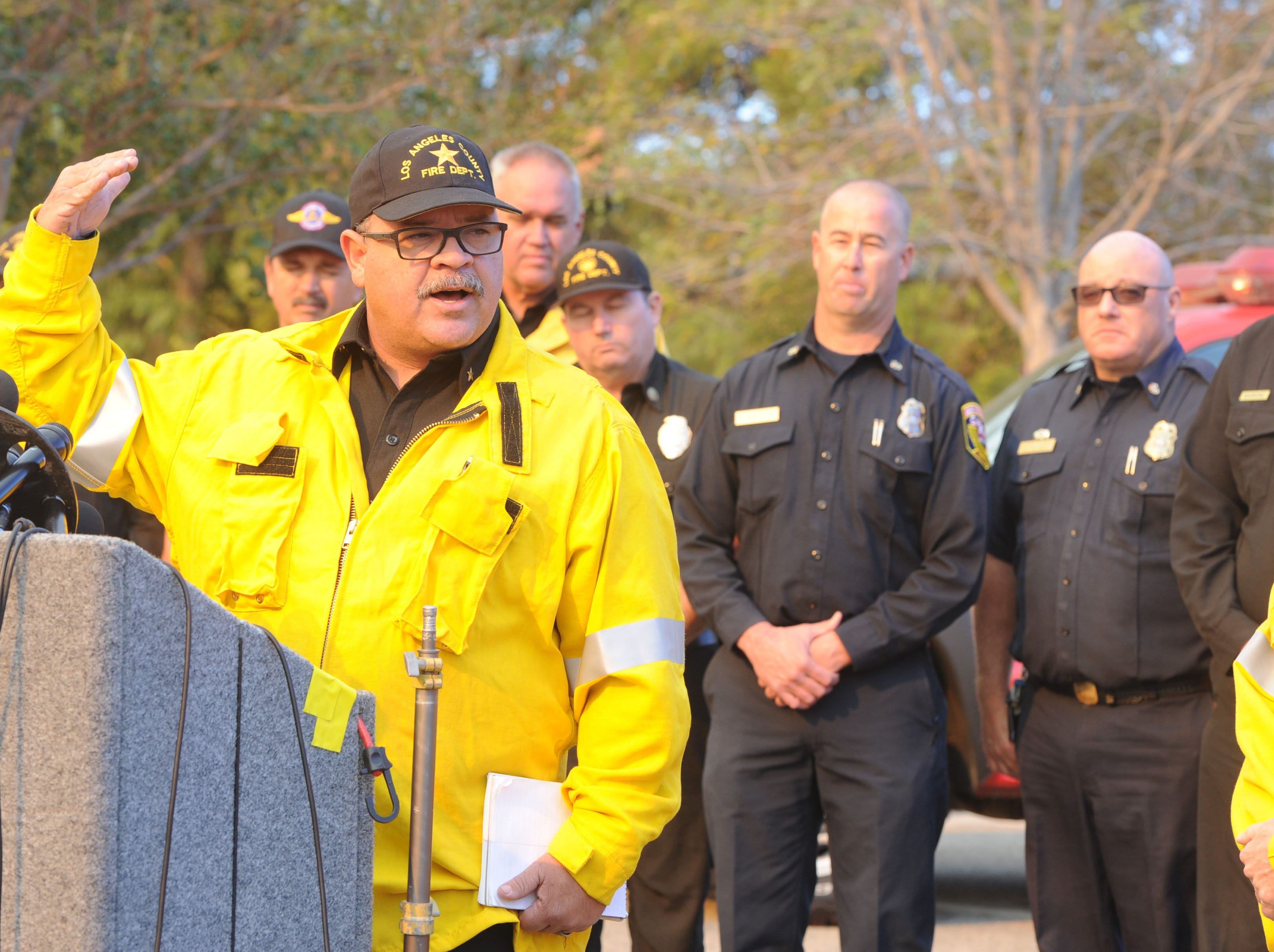Chief Deputy David Richardson, of  the Los Angeles County Fire Department, answers questions about the Woolsey Fire at a news conference at Conejo Creek Park South on Friday morning.