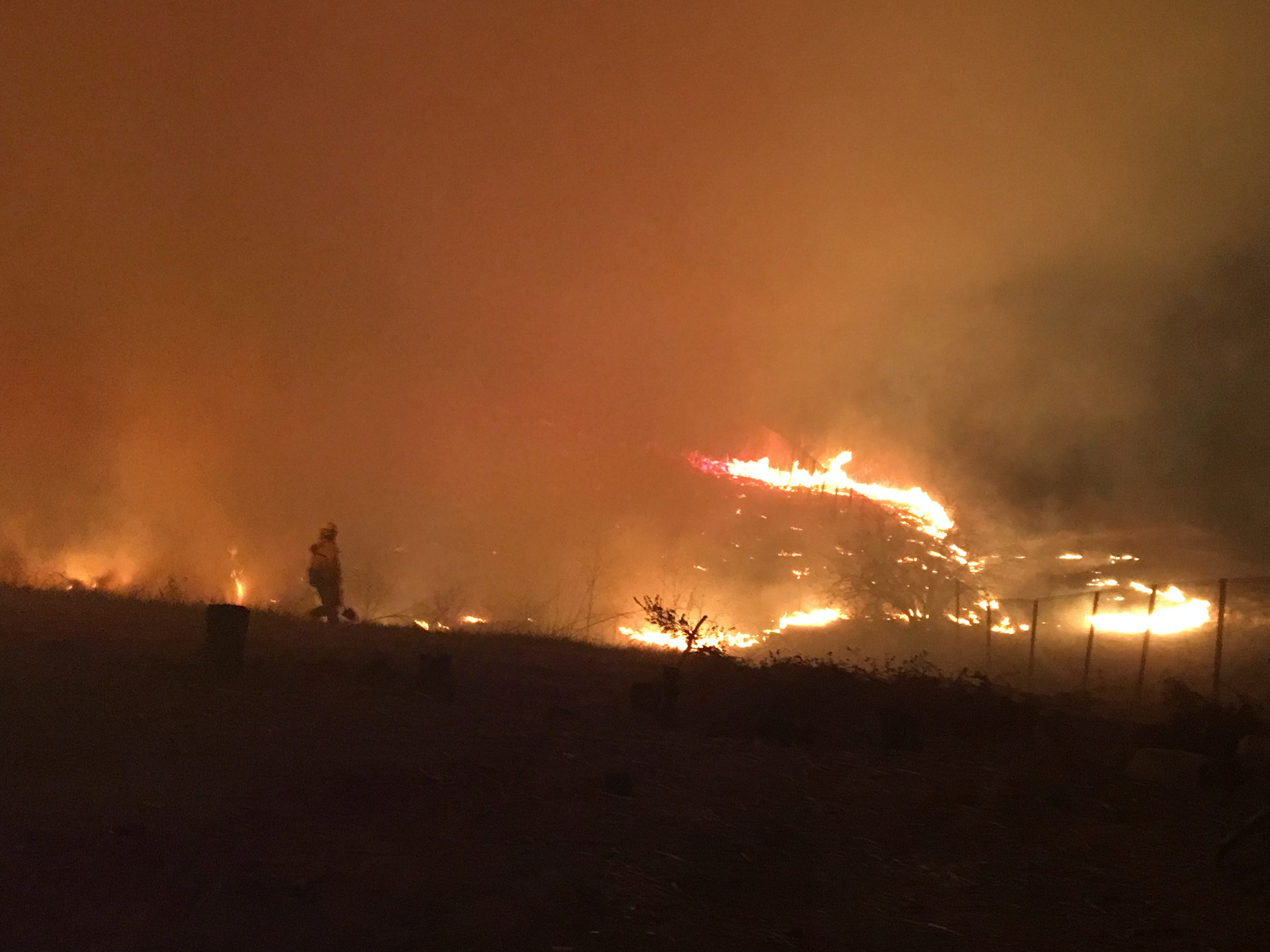Flames from the Woolsey Fire burn north of Highway 101 near Palo Comado Canyon Road.