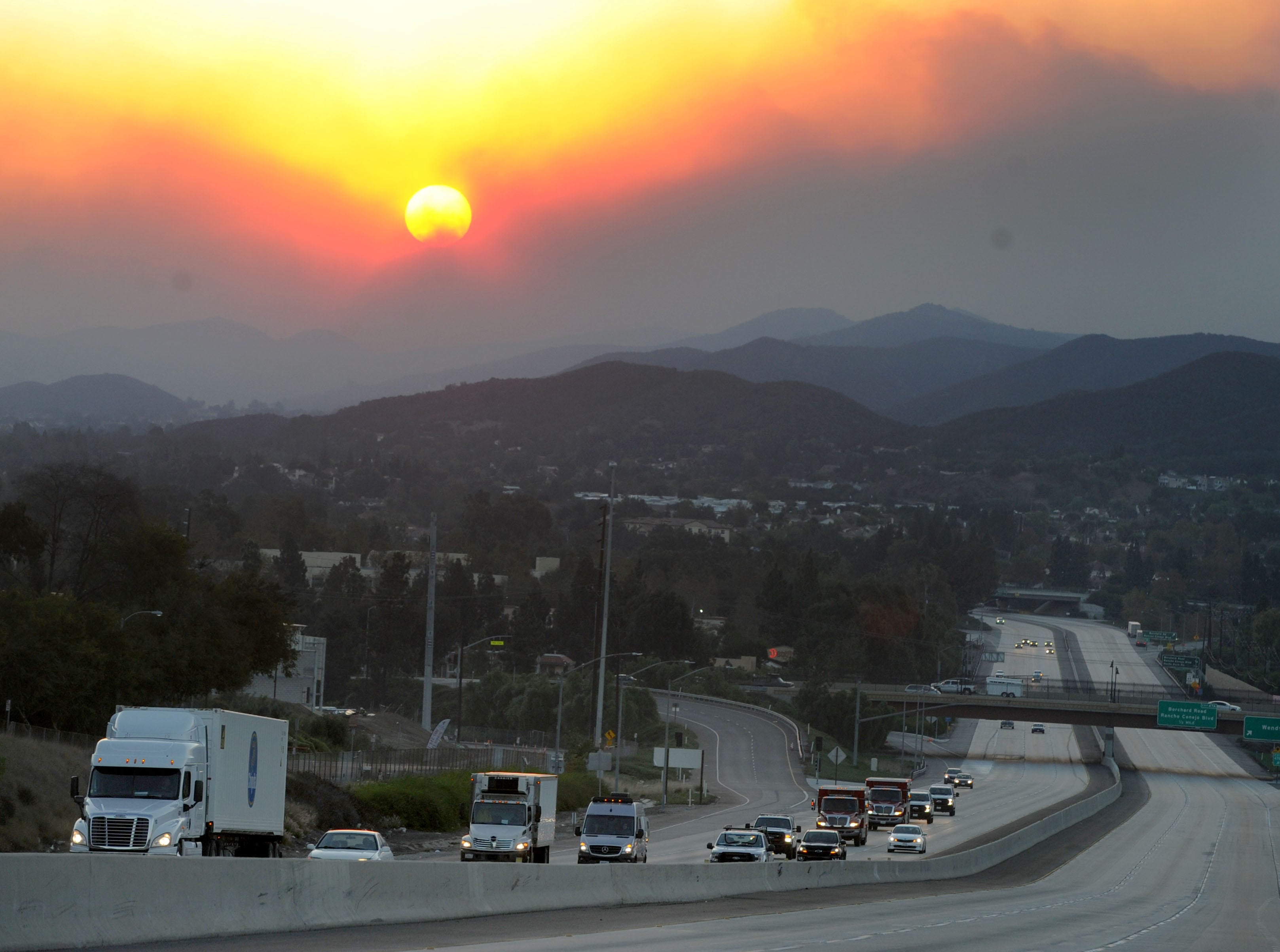 Portions of Highway 101 were closed early Friday because of the Woolsey Fire. The highway later reopened.