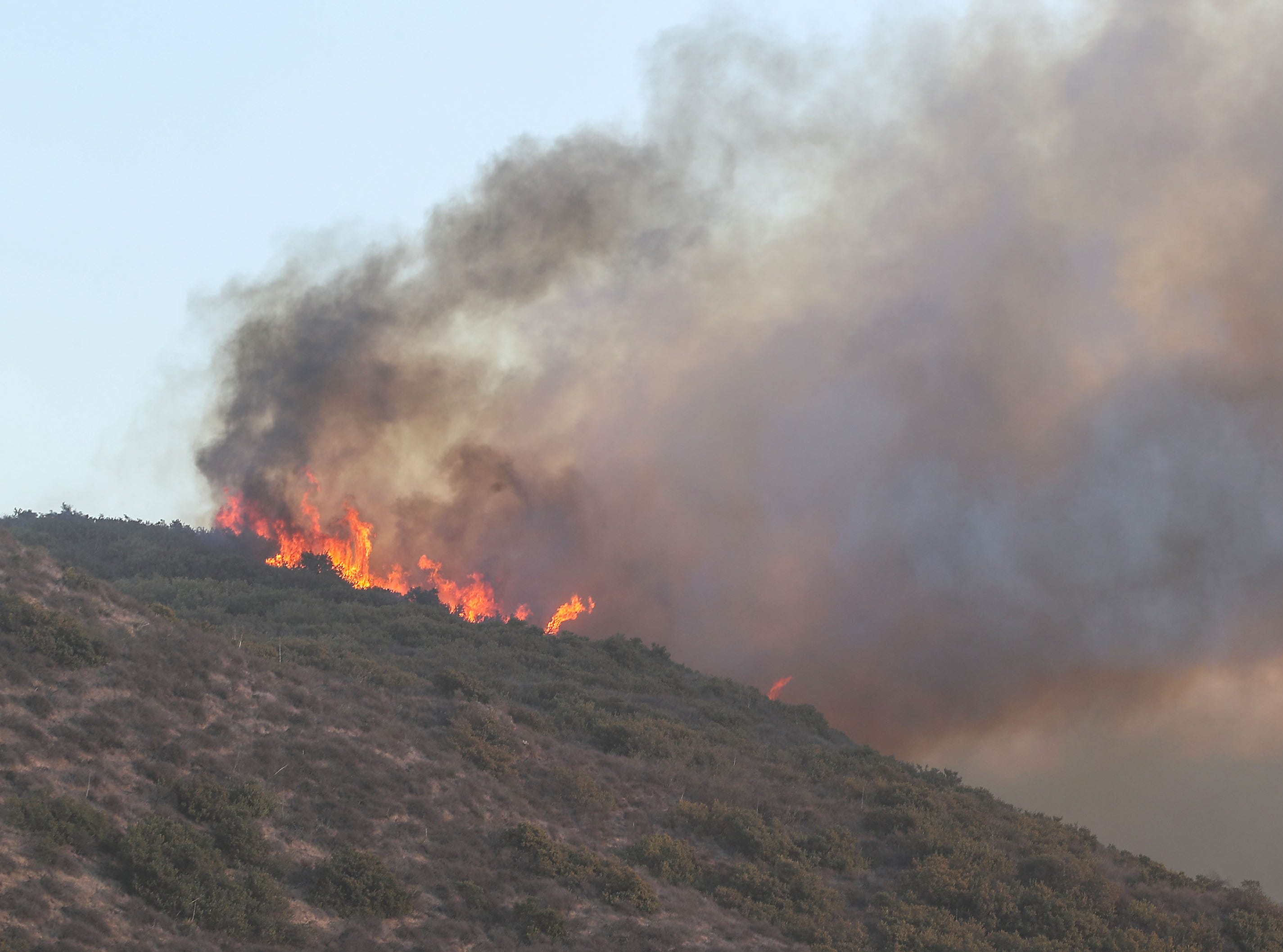 The Hill Fire comes down the hillside near Thousand Oaks at Hill Canyon Road and Santa Rosa Road Thursday afternoon.