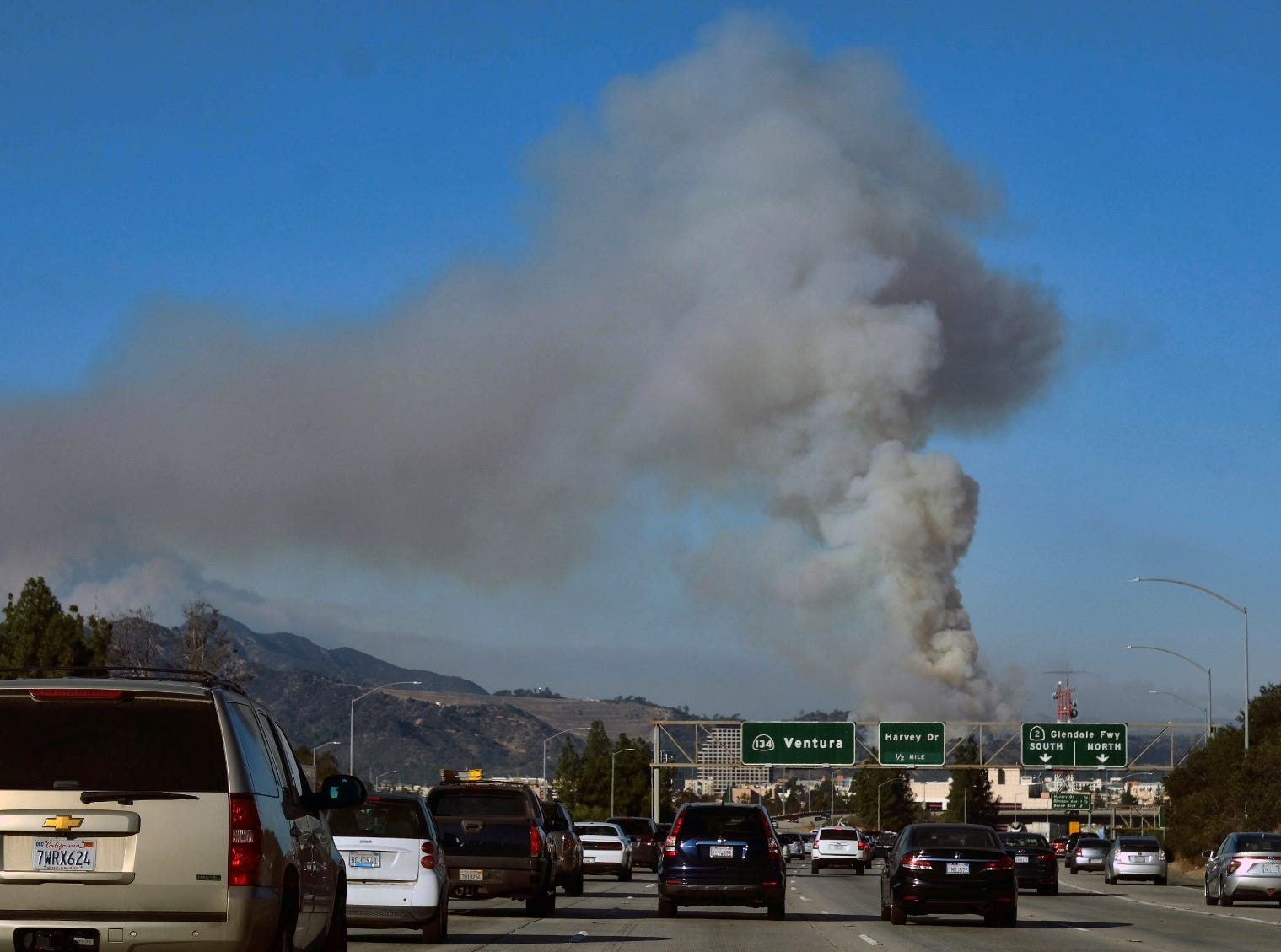 A large plume of smoke from Ventura County wildfires could be seen Friday near Griffith Park in Los Angeles.