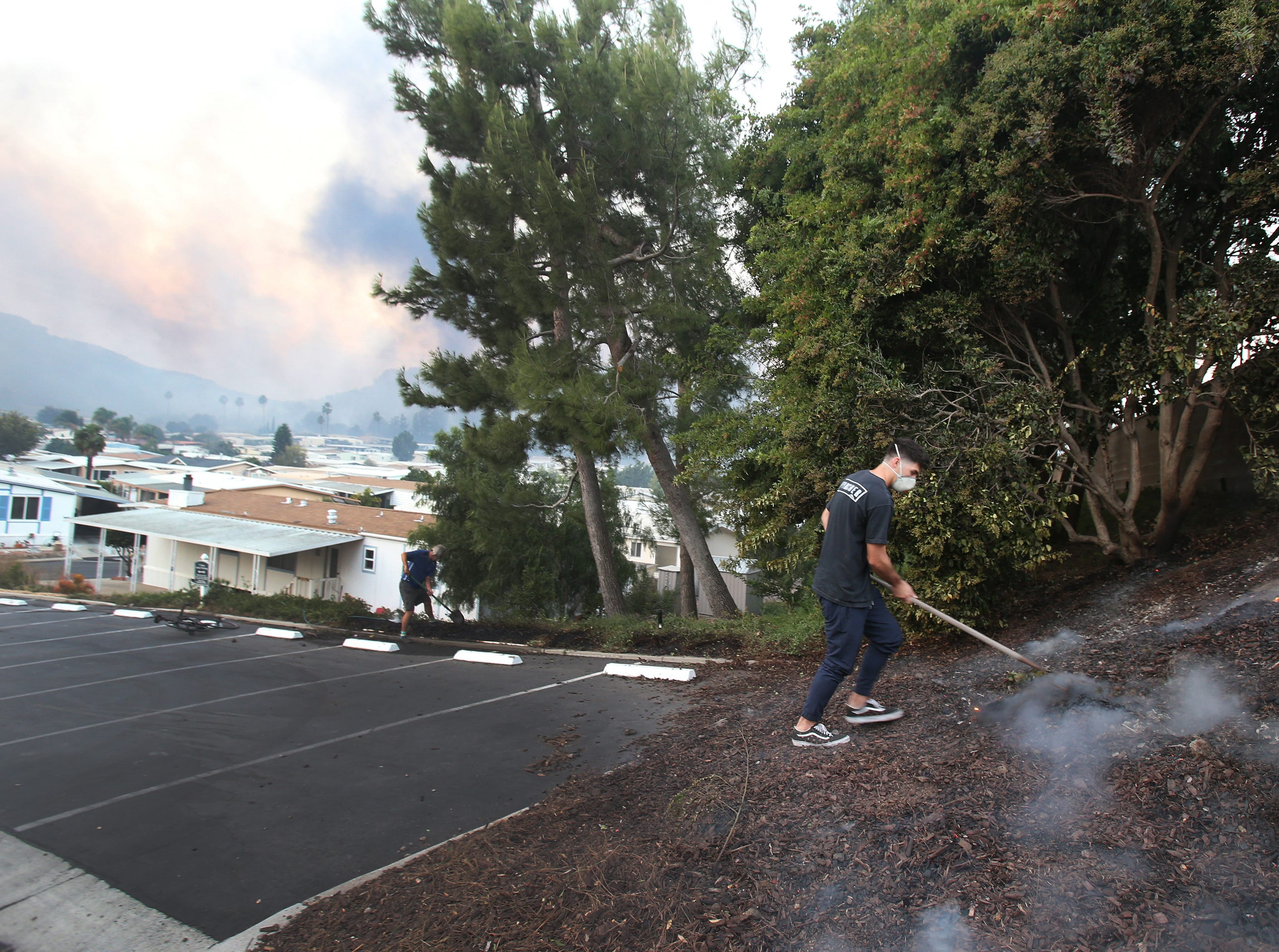 Residents of a mobile park in Newbury Park put of flames from the Hill Fire.