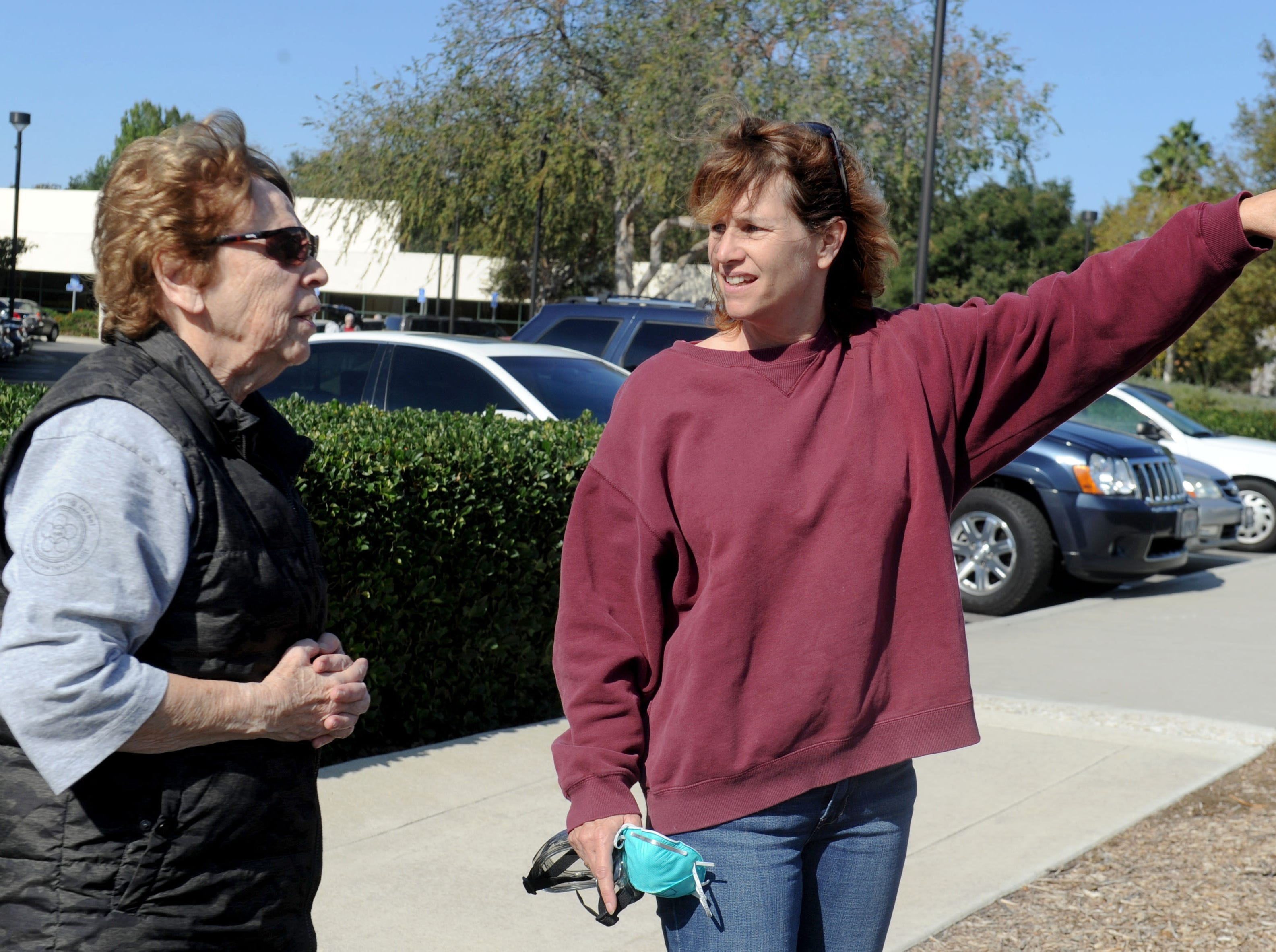 Charlotte Raboy, left, speaks with Allison Moorwood at the Goebel Senior Adult Center in Thousand Oaks on Friday. They were both evacuated from their homes in Thousand Oaks and were staying at the evacuation center.