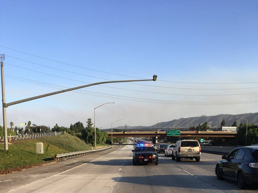 The California Highway Patrol closes off Highway 101 between Camarillo Springs and Newbury Park Thursday afternoon as the Hill Fire burned in the area.